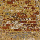 Grunge weathered brick wall red with gray white an. Grunge weathered chipped brick wall red with gray white and yellow ocher peeling paint abstract background stock photos