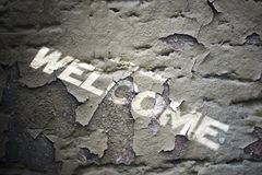 Grunge welcome text. Close up of Grunge welcome text Stock Photos