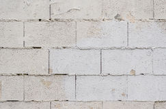 The grunge white brick wall for backgroun. Details of large brick wall cement background gray paint grunge Royalty Free Stock Images