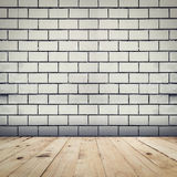 Grunge white brick wall background and wood floor perspective ro Stock Photo