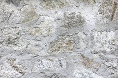 Grunge white concrete and stone wall. Grunge white beige natural wall which made from concrete, sand and stone stock photo