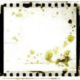 Grunge white film strip frame stained. Retro design element. Grunge white film strip frame stained Royalty Free Stock Images