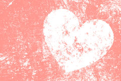 Grunge white heart on pink background Stock Photography