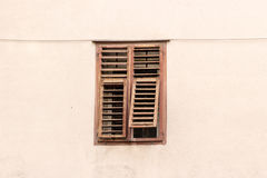 Grunge window with brown shutters Stock Image
