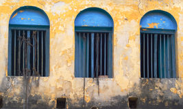 Grunge windows. Three  blue windows on grunge wall Royalty Free Stock Image