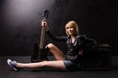 Grunge woman with guitar Stock Photography