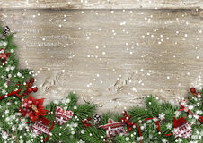Grunge wood background with Christmas firtree, holly&mittens Stock Photography