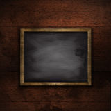 Grunge wood wall background with chalkboard Stock Images