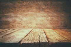 Grunge wooden board table in front of old wooden background Royalty Free Stock Image