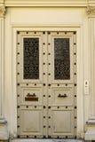 Grunge wooden door. Grunge painted wooden door with bronze handles in Paris Royalty Free Stock Photography