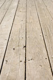Grunge wooden floor with old nails Stock Photography