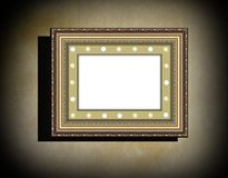 Grunge wooden frame  on  beige  old dirty wall Stock Photography