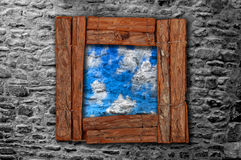 Grunge wooden frame on old stonewall Stock Images