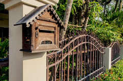Grunge wooden mail box with fence background. Royalty Free Stock Photos