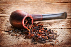 Grunge wooden texture with smoking pipe and tobacco on linen can Royalty Free Stock Image