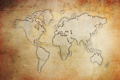 Grunge World Map. The world map on a grunge textured background Stock Photo