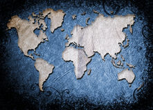 Grunge world map. Illustration in blue texture and swirls burnt border Royalty Free Stock Photos