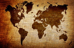 Grunge world map. Brown grunge world map on old canvas texture Royalty Free Stock Photo