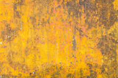Grunge yellow background with some spots and stains on it. Stock Photography