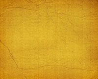 Grunge Yellow paper Background. A yellow colored rough textured grunge background Stock Image