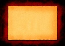Grunge yellow paper framed. Grunge rectangle of yellow paper with perforated edges on a grunge red frame Stock Photo
