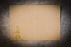 Grunge yellow paper with spot on concrete background Stock Photography