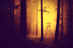 Grunge yellow red color scary forest hunting tower Stock Photography