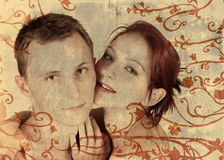 Grunge young couple. In close embrace on texture background with swirl border Stock Image