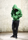 Grunge youth. Youth with green hoodie and grunge background Stock Photos