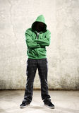 Grunge youth. Youth with green hoodie and grunge background Royalty Free Stock Photography