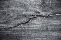 Grunge zwart hout met de grote achtergronden van de barsttextuur Royalty-vrije Stock Foto's