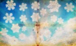 Grungeachtergrond van de winterhemel met grote sneeuwvlokken Stock Afbeelding