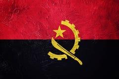 GrungeAngola flagga Angola flagga med grungetextur Arkivfoton