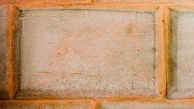 Grungebakgrund från ungefärligt en tegelstenvägg Arkivfoton