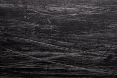 Grungebakgrund med den svarta målarfärgborsten Arkivbilder
