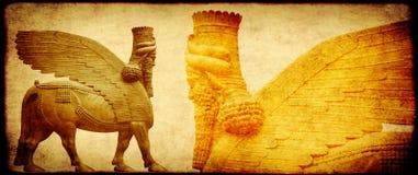 Grungebakgrund med pappers- textur och lamassu Arkivfoto