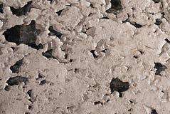 Grungebakgrund med sprucken murbruktextur arkivbilder
