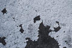 Grungebakgrund med sprucken plaster/ arkivbild
