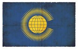 Grungeflagga av brittiska samväldet Storbritannien Royaltyfri Foto