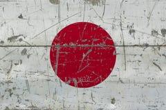 GrungeJapan flagga på gammal skrapad träyttersida Nationell tappningbakgrund stock illustrationer
