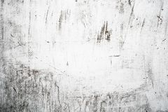 Grungeljus - grå textur av en gammal vägg med svartskilsmässor, vit yttersida med fläckar, abstrakt bakgrund Royaltyfria Bilder