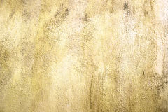 Grungeljus - gul bakgrund för cementväggtextur Royaltyfria Bilder