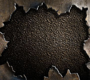 Grungemetallbakgrund med sönderrivna kanter Royaltyfria Foton
