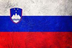 GrungeSlovenien flagga Slovenien flagga med grungetextur Arkivfoto