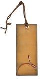 Grungy åldriga pappersetiketter med metallnitar och enkla traditionella rader, isolerad vit bakgrund som specificeras högt Tomt p Fotografering för Bildbyråer