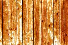 Grungy деревянная предпосылка стены в оранжевом цвете стоковые изображения