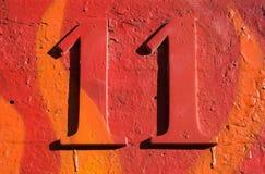 grungy красный цвет номера 11 Стоковые Фото