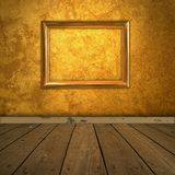 Grungy amber room with frame and spotlight Stock Photos