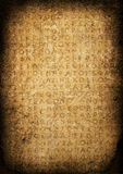 Grungy Ancient Tablet with Archaic Language Stock Images