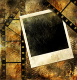 Grungy art. Grunge background with film strips and instant frame Stock Photography